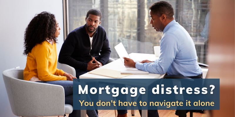 Mortgage Distress? You don't have to navigate it alone. Pictured: Couple in an office with a financial officer, looking distressed over mortgage issues.